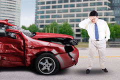 Overweight person and damaged car Royalty Free Stock Photos