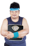 Overweight person holding weight scale Stock Photo