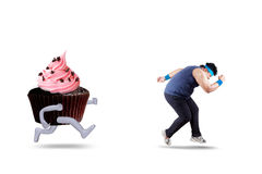 Overweight person refuse to eat cupcake Royalty Free Stock Photography