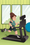 Overweight person running on a treadmill in a gym Stock Photography