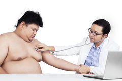 Overweight person visiting doctor Stock Photos