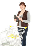 Overweight shopping woman taking fifty euro Royalty Free Stock Images