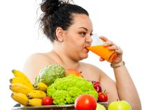 Overweight teen drinking fruit juice. Royalty Free Stock Image