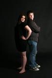 Overweight Teenage Couple Standing Back To Stock Image