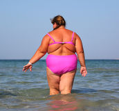 Overweight woman bath in sea Royalty Free Stock Photo