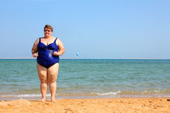 Overweight woman on beach Royalty Free Stock Images