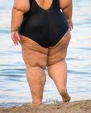 Overweight woman. Overweight woman on the beach. Unrecognizable person Royalty Free Stock Images