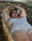 Overweight woman on beach Stock Image