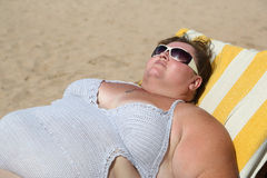 Overweight woman on beach Royalty Free Stock Photo