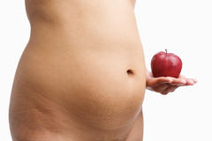 Overweight woman body holding apple Royalty Free Stock Photos
