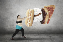 Overweight woman boxing junk foods Stock Photography