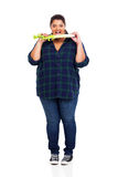 Overweight woman celery Royalty Free Stock Photo