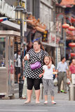 Overweight woman with child, Beijing, China Stock Photography