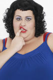 Overweight Woman Curling Lip And biting Finger Royalty Free Stock Photo
