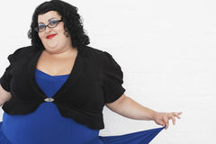 Overweight Woman Curtseying Royalty Free Stock Image