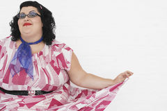 Overweight Woman Curtseying Royalty Free Stock Images