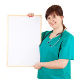 Overweight woman doctor keeping blank sign Stock Photo