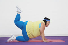 Overweight Woman Doing Aerobic Stretches Royalty Free Stock Image