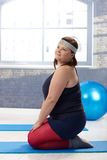 Overweight woman doing gymnastics. At the gym Stock Images