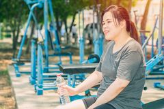 Asian smile woman drinking water after workout stock images