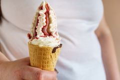 Overweight woman eating ice-cream. fattening food. Overweight woman eating ice-cream. unhealthy fattening food,high-calorie snack. fattie with sundae in waffle royalty free stock image