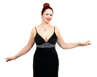 Overweight woman with elegant dress. Hands around the body and red hair Stock Photo