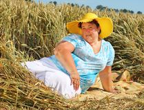 Overweight woman enjoying life during summer vacations. Stock Image