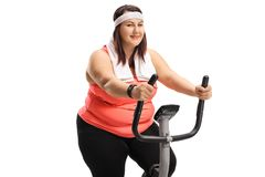 Overweight woman on an exercise bike. Isolated on white background Stock Photography