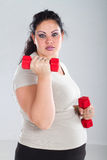Overweight woman exercising Stock Image