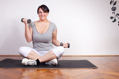 Overweight woman exercising Stock Images
