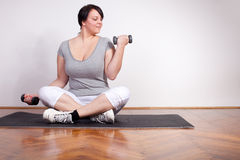 Overweight woman exercising Royalty Free Stock Photo