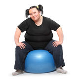 Overweight woman exercising. Royalty Free Stock Photos