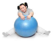 Overweight woman exercising. Royalty Free Stock Image