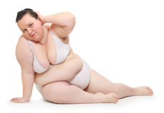 Overweight woman exercising. Royalty Free Stock Photography