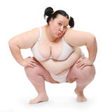 Overweight woman exercising. Stock Photography