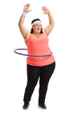 Overweight woman exercising with a hula-hoop Stock Photo
