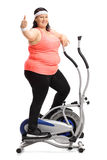 Overweight woman exercising and making thumb up sign Stock Images