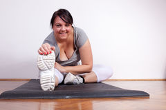 Overweight woman exercising/stretching Royalty Free Stock Image