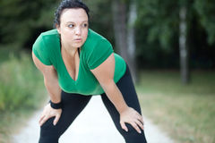 Plus size woman exhausted Stock Image