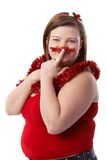 Overweight woman having fun at Christmas Royalty Free Stock Image