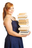 Overweight woman holding books. Overweight woman in skirt holding heavy books Stock Images