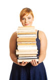 Overweight woman holding books Royalty Free Stock Images