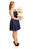 Overweight woman holding heavy books Royalty Free Stock Image