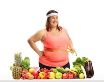 Overweight woman holding a measuring tape around her waist Stock Images