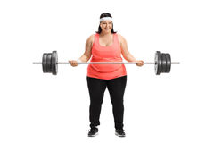 Overweight woman lifting a big dumbbell Stock Photos