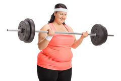 Overweight woman lifting a big dumbbell Royalty Free Stock Photography