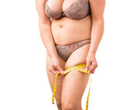 Overweight woman measuring her hip Royalty Free Stock Photos