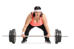 Overweight woman preparing to lift a barbell. Isolated on white background Stock Photos