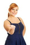 Overweight woman presenting something Stock Images