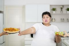 Overweight woman refusing to eat pizza stock photography